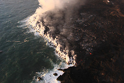 Handout photo of lava was entering the ocean over a broad area this morning. This image shows an active entry area along the northern flow front at Kapoho. View to the south. Kilauea Volcano, HI, USA, June 30, 2018. Photo by USGS via ABACAPRESS.COM
