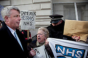 Health Secretary and architect of the NHS reform bill MP Andrew Lansley is heckled and jostled as he arrived to attend a meeting on the future of the NHS. Protesters gathered outside on Whitehall in a demonstration called 'Summit of the Uninvited', Downing Street, London, UK. Outside the Prime Minister's summit meeting where he invited selected health professionals and private companies to discuss implementation of the health bill, and excluded all the organisations critical of the bill. <br /> <br /> It has been alleged this shows the government's desperation that they have had to rapidly convene this meeting to try to cobble this together at the last minute to try to show they still have some professional support and to split the profession and marginalise those who are critical.