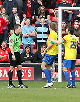 Photo: Mark Stephenson.<br />Walsall v Hereford United. Coca Cola League 2. 09/04/2007. Referee Mr G J Sutton shows Hereford's Dean Beckwith a red card for a foul