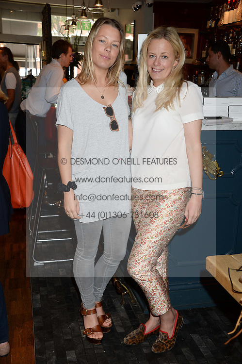 Left to right, sisters DAVINA HARBORD and ASTRID HARBORD at the Glamorous Girls Summer Sale and Park Walk Street Party, Park Walk, London SW10 on 27th June 2013.