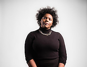 """TUSCALOOSA, AL – DECEMBER 10, 2015: Amanda K. Bennett, 21, poses for a portrait at the University of Alabama. Bennett, a senior English and African American studies major in the Honors College, organized the """"We are Done"""" campaign in 2015. """"I was motivated by years of letting systemic injustices and micro aggressions happen around me,"""" Bennett said. """"I realized that I could no longer be a passive bystander to inequality."""" CREDIT: Bob Miller for The New York Times"""