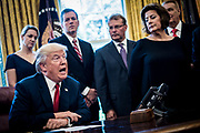 Steel industry and and labor leaders look on as President Donald Trump prepares to sign  a memorandum ordering the investigation of whether foreign steel imports are harming US national security in the Oval Office of the White House in Washington, District of Columbia, U.S., on Thursday, April 20, 2017.  The order directs Commerce Secretary Wilbur Ross to conduct the within 270 days, before Trump decides on curbing the import of foreign steel.