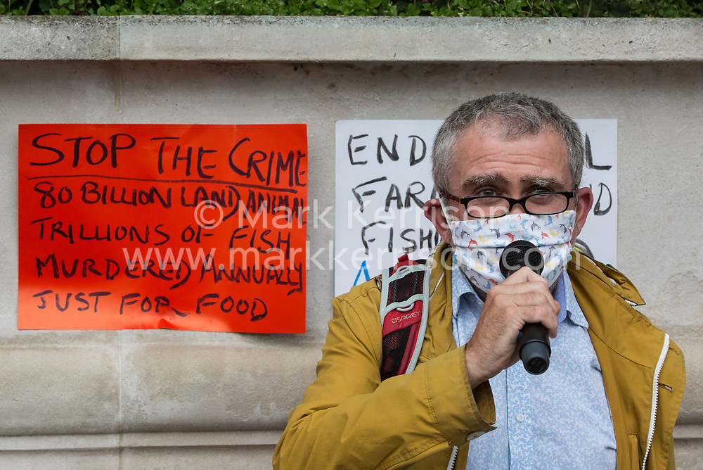 Marine ecologist Professor Alex Rogers addresses climate activists from the Ocean Rebellion and Extinction Rebellion preparing to take part in a colourful Marine Extinction March on 6 September 2020 in London, United Kingdom. The activists, who are attending a series of September Rebellion protests around the UK, are demanding environmental protections for the oceans and calling for an end to global governmental inaction to save the seas.