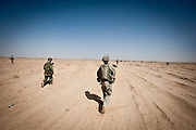 Soldiers head out on patrol in Zhari District, Kandahar Province.