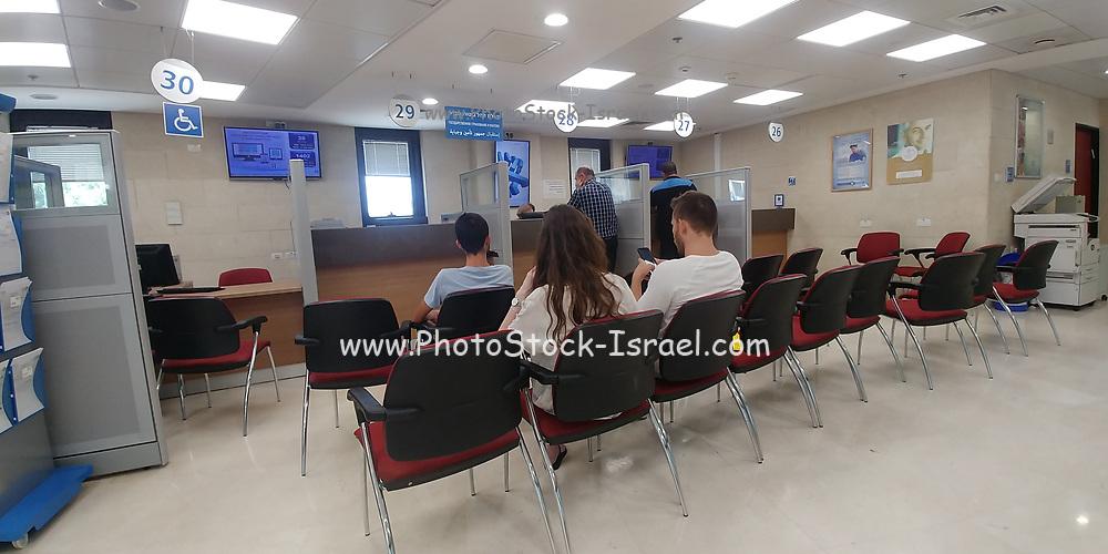 Israeli Bureaucracy. Citizens wait in line for governmental service