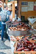 Food stalls in an outdoor Sunday market in Rossio Square, Lisbon, Portugal