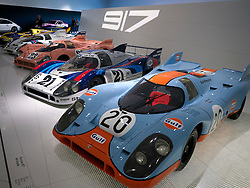 Collection of Porsche 917 race cars on display at Porsche Museum in Stuttgart Germany