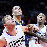 25 November 2015: Utah Jazz center Rudy Gobert (27) vies for the rebound with Los Angeles Clippers guard Jamal Crawford (11) and Los Angeles Clippers forward Blake Griffin (32) during the Utah Jazz 102-91 victory over the Los Angeles Clippers, at the Staples Center, Los Angeles, California, USA.