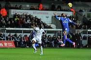 Everton's Sylvain Distin ® in action. . Barclays Premier league, Swansea city v Everton at the Liberty Stadium in Swansea,  South Wales on Sunday 22nd Dec 2013. pic by Andrew Orchard, Andrew Orchard sports photography.