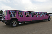 "8/24/16 Jackson,MS.Trump supporter Ralph Cahill decorated his bright pink Hummer limo with poster size photos of Donald J. Trump and parked it out front of the Jackson coliseum.  Republican Presidential candidate Donald J. Trump stumps in Jackson Mississippi at the coliseum to a full house of supporters and calls Hillary Clinton a ""bigot"" during his speech. While in Jackson Trump also made time to squeezed in a very private $1,000 dollar  per person fundraiser. It was so private you did not get the address for the location until the campaign received your donation. Photo © Suzi Altman"