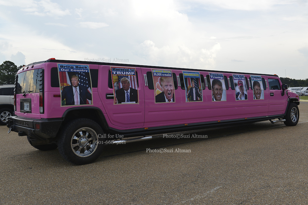 """8/24/16 Jackson,MS.Trump supporter Ralph Cahill decorated his bright pink Hummer limo with poster size photos of Donald J. Trump and parked it out front of the Jackson coliseum.  Republican Presidential candidate Donald J. Trump stumps in Jackson Mississippi at the coliseum to a full house of supporters and calls Hillary Clinton a """"bigot"""" during his speech. While in Jackson Trump also made time to squeezed in a very private $1,000 dollar  per person fundraiser. It was so private you did not get the address for the location until the campaign received your donation. Photo © Suzi Altman"""