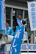 Hisshou Yanai  campaigning for the Happiness Realisation Party in Shinjuku, Tokyo, Japan Wednesday May 26th 2010