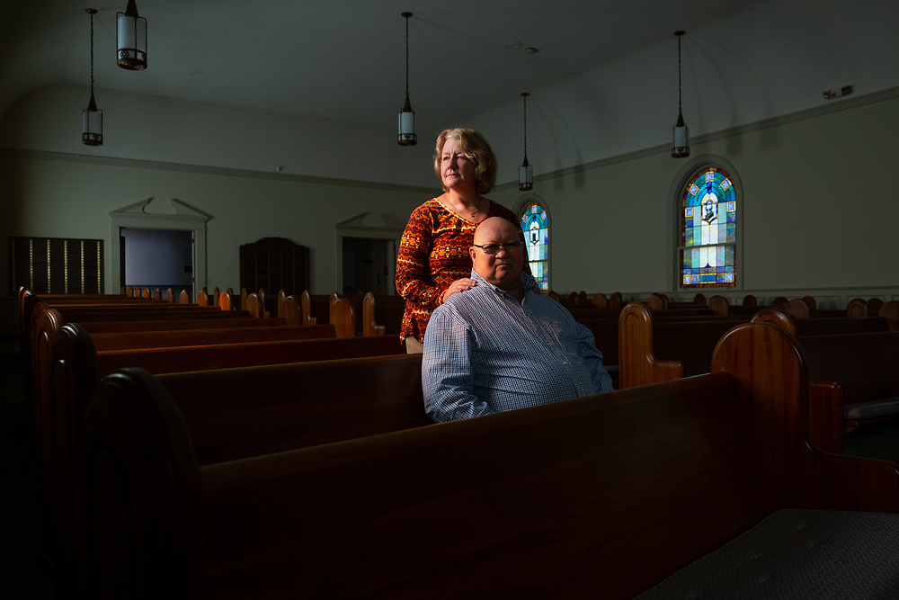 DOTHAN, AL - DECEMBER 4: Story about Lisa and Kenny Priddle, who one of several families who moved to Dothan, Ala. for $50,000. It was part of the Jewish Community Services Relocation Project to attract more Jews to the city in south Alabama. <br /> <br /> Here, the Priddles pose for a portrait in the sanctuary at Temple Emanu-El.<br /> <br /> (Photo by Kevin D. Liles for The Washington Post)