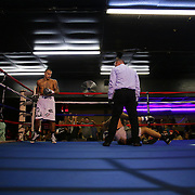 """Radivoje """"Hot Rod"""" Kalajjdic knocks out Gilberto Domingos during the Mad Integrity Fight sports boxing match at the Florida Orange Event Center in Lakeland, Florida on Saturday October 10, 2015. Photo: Alex Menendez"""