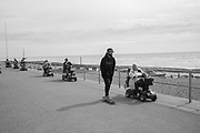 Luke Barningham showing support from the Skate Park Action group, Sue Szlafke in front, Grand Parade of mobility scooters, Bexhill wheel and walk mobility carriages. Proceeds to Bexhill Caring Community. 16 September 2018