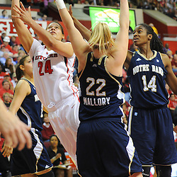 Rutgers Scarlet Knights guard/forward April Sykes (24) takes a shot past Notre Dame Fighting Irish guard Brittany Mallory (22) during second half NCAA Big East women's basketball action between Notre Dame and Rutgers at the Louis Brown Athletic Center. Notre Dame defeated Rutgers 71-41.