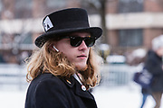 Brooklyn, NY - 2 March 2019. A man wears a low top hat with an ace of spades playing card in the hatband at Bernie Sanders' first rally for the 2020 presidential primary at Brooklyn College.