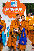 "23 APRIL 2013 - BANGKOK, THAILAND:  Buddhist monks and novices walk past a sign announcing Bangkok is the 2013 UNESCO World Book Capital. UNESCO awarded Bangkok the title. Bangkok is the 13th city to assume the title of ""World Book Capital"", taking over from Yerevan, Armenia. Bangkok Governor Suhumbhand Paribatra announced plans that the Bangkok Metropolitan Administration (BMA) intends to encourage reading among Thais. The BMA runs 37 public libraries in the city and has modernised 14 of them. It plans to build 10 more public libraries every year. Port Harcourt, Nigeria will be the next World Book Capital in 2014. .PHOTO BY JACK KURTZ"