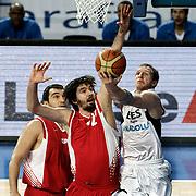 Efes Pilsen's Sinan GULER (R) during their Turkish Basketball league match Efes Pilsen between Erdemir at the Sinan Erdem  Arena in Istanbul Turkey on Saturday 29 January 2011. Photo by TURKPIX