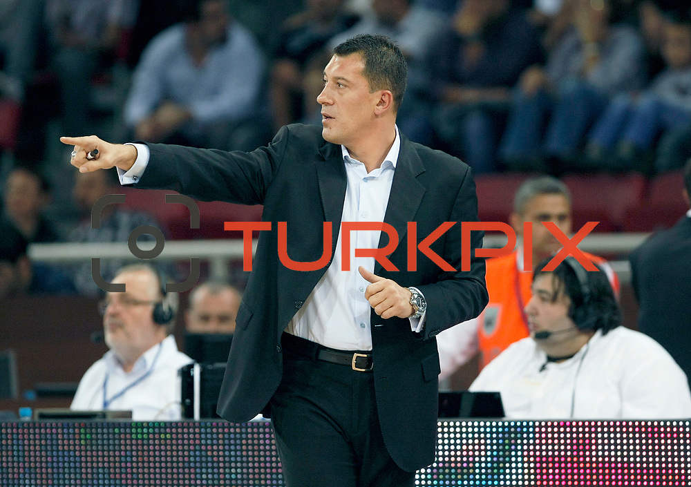 Anadolu Efes's coach Ufuk SARICA during their Two Nations Cup basketball match Anadolu Efes between Panathinaikos at Abdi Ipekci Arena in Istanbul Turkey on Saturday 01 October 2011. Photo by TURKPIX