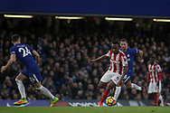 Saido Berahino of Stoke City looks to go past Gary Cahill of Chelsea (l). <br /> Premier league match, Chelsea v Stoke city at Stamford Bridge in London on Saturday 30th December 2017.<br /> pic by Kieran Clarke, Andrew Orchard sports photography.