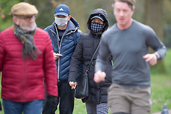 ©Licensed to London News Pictures 20/03/2020<br /> Greenwich, UK. Coronavirus threat. People out and about with protective face masks on in Greenwich Park, Greenwich, London. Photo credit: Grant Falvey/LNP