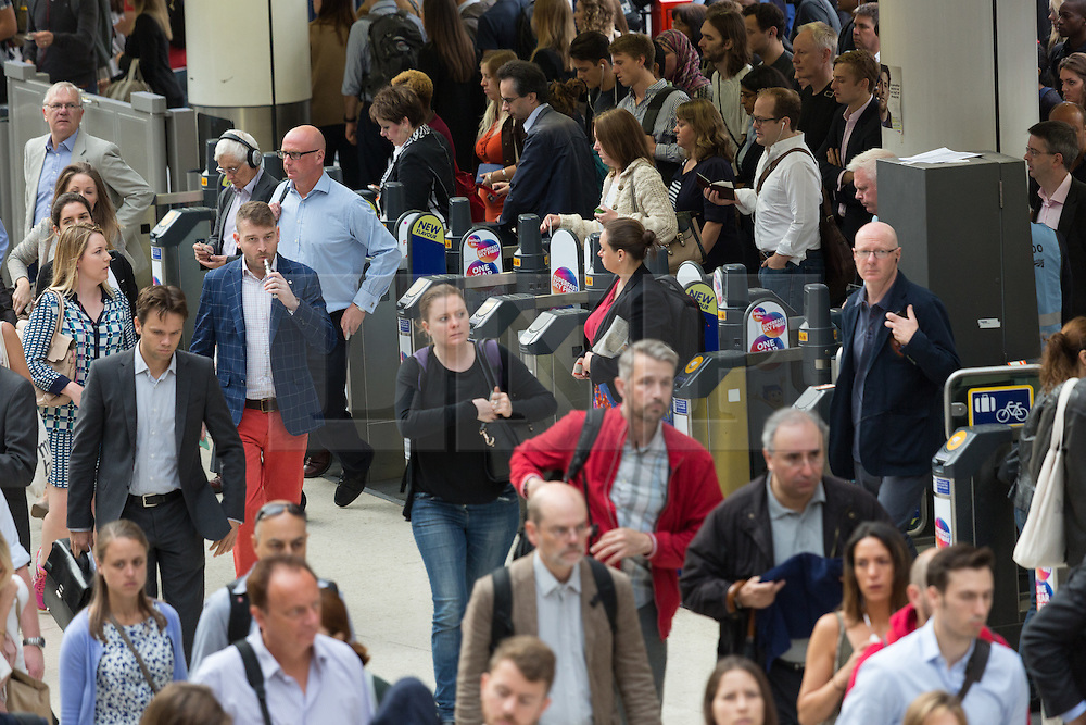 © Licensed to London News Pictures. 06/08/2015. London, UK. Crowds of commuters at Waterloo station in London. A tube strike today has closed the TfL London Underground network as members of four unions take industrial action for the second time in a month because of a deadlocked dispute over plans to launch a new all-night tube train service next month. Extra busses have been laid on to help commuters get to work. Photo credit : Vickie Flores/LNP