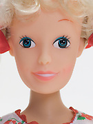 close up of a blond doll face.