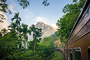 Passengers on thr train from Colombo to Kandy in Sri Lanka are greeted by impressive views of Alagalla mountain.