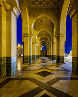 CASABLANCA, MOROCCO - CIRCA APRIL 2018: Exterior corridor and arches of the mosque  Hassan II in Casablanca at night.