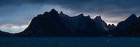 Steep mountains of Moskenesøy rise from across Reinefjord, Reine, Lofoten Islands, Norway