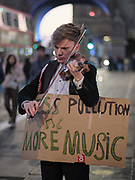 Violinist Yury Revich performs solo on a Stradivari violin from the year 1709 (estimated worth of €8 million euros) at the Tower Bridge of London on Tuesday, Dec 15, 2020. <br /> He is protesting against heavy automotive traffic pollution while concert halls are held under the lockdown restrictions due to the coronavirus pandemic outbreak in Britain. Revich tuned into his violin for ten minutes, which he says that it is 'an artistic statement against car pollution, while concert halls are being closed', adding that the venues are closed but the music isn't. (VXP Photo/ Giovanni Strondl)