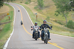Thomas Trapp, the Harley-Davidson dealer from Frankfurt, Germany riding his 1916 Harley-Davidson F with Marcin Grela of Poland on his 1936 Harley-Davidson VLH during Stage 7 of the Motorcycle Cannonball Cross-Country Endurance Run, which on this day ran from Sedalia, MO to Junction City, KS., USA. Thursday, September 11, 2014.  Photography ©2014 Michael Lichter.
