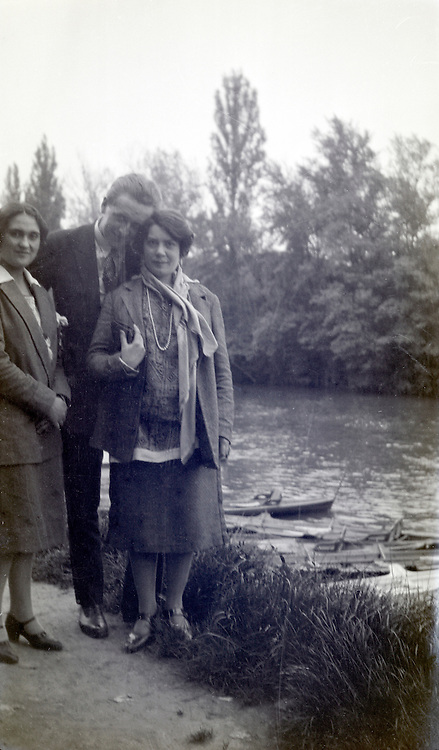 young adult man posing with a girlfriend and a a female friend 1920s
