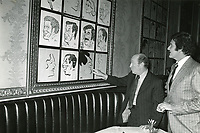 1978 Writer director, Garson Kanin points to the caricature of Cary Grant while radio commentator Gregg Hunter looks on at the Brown Derby in Hollywood