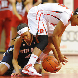 Notre Dame Fighting Irish guard Skylar Diggins (4) steals the ball away from Rutgers Scarlet Knights guard Briyona Canty (25) during first half NCAA Big East women's basketball action between Notre Dame and Rutgers at the Louis Brown Athletic Center. Notre Dame leads 40-23 at halftime.