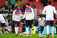 England Midfielder Raheem Sterling (10) and England Midfielder Dele Alli (20) warm up ahead of the Friendly match between England and Italy at Wembley Stadium, London, England on 27 March 2018. Picture by Stephen Wright.