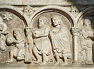 Scenes from the life of Christ - The Coming of the Three Kings - the work of the sculptor Nicholaus, on the main portal  of the 12th century Romanesque Ferrara Duomo, Italy . Ferrara Cathedral (Basilica Cattedrale di San Giorgio, Duomo di Ferrara) is a Roman Catholic cathedral and minor basilica in Ferrara, Northern Italy. The original Romanesque design of Ferrara Cathedral is manifest in the façade. In the centre of the façade of Ferrara Cathedral is a porch, supported by two columns with Atlases seated on lions at the bases. It is decorated with a Last Judgement by an unknown master and a loggia with a Madonna and Child (a late Gothic addition). The portal of Ferrara Cathedral is the work of the sculptor Nicholaus, a pupil of Wiligelmus. The lunette shows Saint George, patron saint of Ferrara, slaying the dragon; scenes from the Life of Christ appear on the lintel. The jambs framing the entrance of Ferrara Cathedral are embellished with figures depicting the Annunciation and the four prophets who foretold the coming of Christ.<br /> <br /> Visit our ITALY PHOTO COLLECTION for more   photos of Italy to download or buy as prints https://funkystock.photoshelter.com/gallery-collection/2b-Pictures-Images-of-Italy-Photos-of-Italian-Historic-Landmark-Sites/C0000qxA2zGFjd_k<br /> <br /> If you prefer to buy from our ALAMY PHOTO LIBRARY  Collection visit : https://www.alamy.com/portfolio/paul-williams-funkystock/ferrara.html .