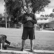 Non-essential businesses such as gyms were ordered closed, so people are literally taking to the streets for fitness. Michael gasps for air after sprints, push-ups, lunges and squats in the street.