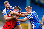 Halifax RLFC interchange Brandon Moore (14) in the tackle  during the Betfred Championship match between Halifax RLFC and London Broncos at the MBi Shay Stadium, Halifax, United Kingdom on 8 April 2018. Picture by Simon Davies.