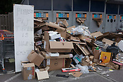 Despite a warning of CCTV, piles of fly-tipped cardboard have been dumped in a private Sainsburys car park and recycling centre, on 19th September 2016, in Dulwich, south London. Sainsburys here in Dulwich has a growing problem with fly-tipping rubbish despite security checks and CCTV present.