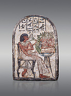 """Ancient Egyptian Ra stele , limestone, New Kingdom, 19th Dynasty, (1279-1190 BC), Deir el-Medina,  Egyptian Museum, Turin. Grey background.<br /> <br /> On this round-topped stele, the deceased Pashed, <br /> """"excellent spirit of Ra"""", akh-ikr, is pictured left, <br /> seated on a chair with lion's paws, smelling the lotus <br /> flower. The offering table holds a basket containing <br /> various offerings. A large open pomegranate, containing <br /> a great quantity of seeds, appears under the chair. The <br /> colours on this stele are well preserved.<br /> <br /> Akh iqer en Ra """" the excellent spirit of Ra' stele. The individual is smelling a lotus flower. One of three stele forund in different rooms of houses in Deir el-Medina where they stood in niches. .<br /> <br /> If you prefer to buy from our ALAMY PHOTO LIBRARY  Collection visit : https://www.alamy.com/portfolio/paul-williams-funkystock/ancient-egyptian-art-artefacts.html  . Type -   Turin   - into the LOWER SEARCH WITHIN GALLERY box. Refine search by adding background colour, subject etc<br /> <br /> Visit our ANCIENT WORLD PHOTO COLLECTIONS for more photos to download or buy as wall art prints https://funkystock.photoshelter.com/gallery-collection/Ancient-World-Art-Antiquities-Historic-Sites-Pictures-Images-of/C00006u26yqSkDOM"""