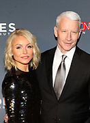December 17, 2017-New York, NY-United States: (L-R) On-Air Personality Kelly Ripa and Journalist Anderson Cooper attend the 11th Annual CNN Heroes All-Star Tribute held at the American Museum of Natural History on December 18, 2017 in New York City. The All-Star Tribute ceremony honors everyday people changing the world. Terrence Jennings/terrencejennings.com