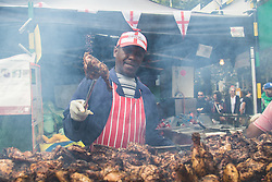 London, August 28th 2016. Hundreds of stalls offer freshly barbecued jerk chicken and other West Indian street food as Europe's biggest street party, the Notting Hill Carnival gets underway.