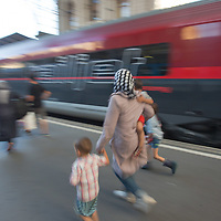 Illegal migrant family rushes get on their train to travel to Germany at the main railway station Keleti in Budapest, Hungary on August 31, 2015. ATTILA VOLGYI