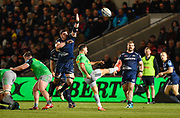 Harlequins scrum-half Danny Care puts up a kick under pressure from Sale Sharks lock James Phillips during a Gallagher Premiership match won by Sale Sharks 27-17 at the AJ Bell Stadium, Eccles, Greater Manchester, United Kingdom, Friday, April 5, 2019. (Steve Flynn/Image of Sport)