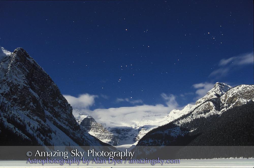 Orion over Lake Louise, Banff National Park, Alberta<br /> March 1995 at Full Moon<br /> 28mm lens at f/2.8<br /> Ektachrome 400 slide film