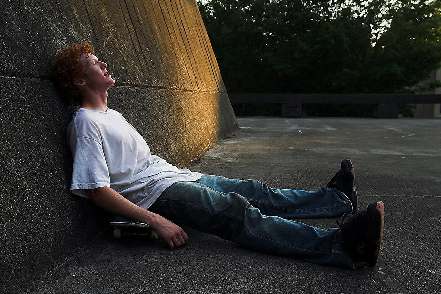 Trevor Fenner sleeps on his skateboard after a session on the angular concrete features by Garfield High School, in Seattle, Washington. Fenner, who grew up in Seattle, now lives in Los Angeles and came back for the summer to look for work.