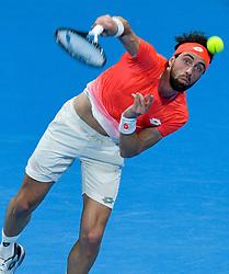 Nikoloz Basilashvili of Georgia serves to Novak Djokovic of Serbia during their Quarter - Final of ATP Qatar Open Tennis match at the Khalifa International Tennis Complex in Doha, capital of Qatar, on January 03, 2019. Novak Djokovic won 2-1  (Credit Image: © Nikku/Xinhua via ZUMA Wire)