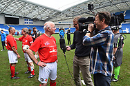 Tommy Charlton of England over 60's being interviewed for the TV at full time during the world's first Walking Football International match between England and Italy at the American Express Community Stadium, Brighton and Hove, England on 13 May 2018. Picture by Graham Hunt.